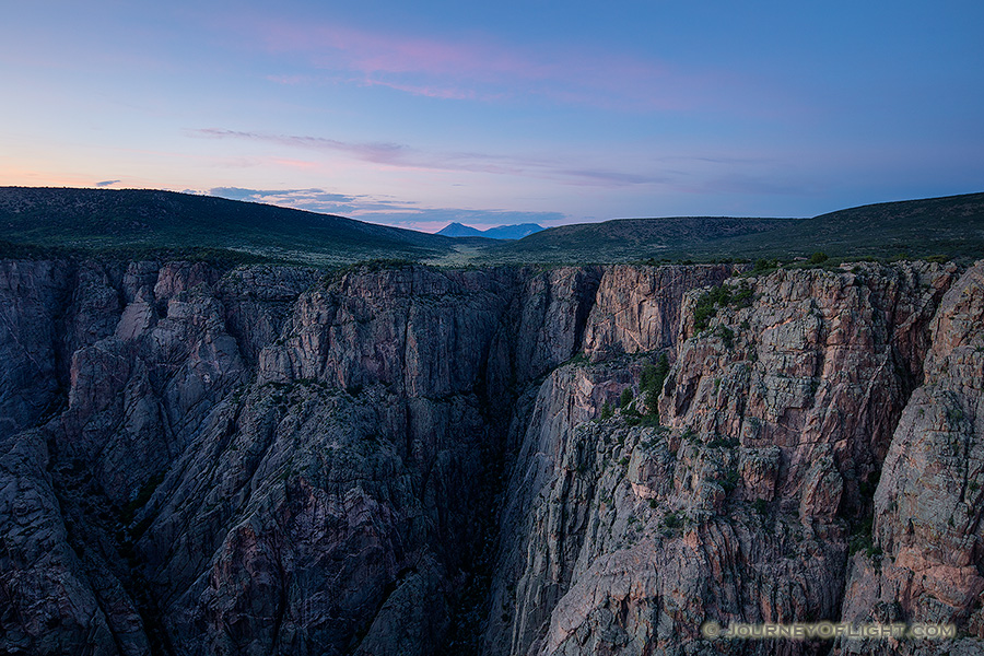 As twilight descends into the Black Canyon of the Gunnison blue hues dominate the sky and the walls. - Colorado Photography