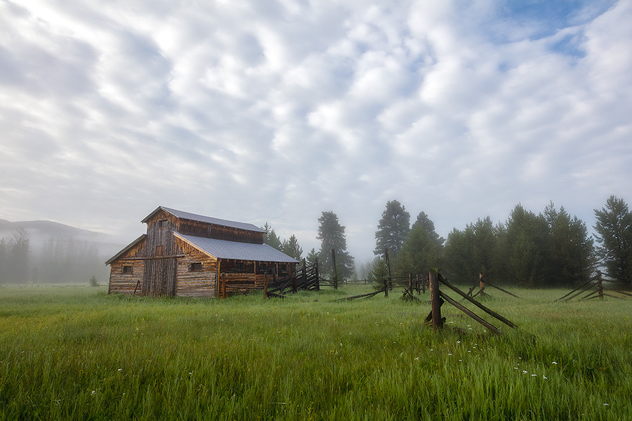 Fog rolls through the Kawuneeche Valley and surrounds this old rustic barn in Rocky Mountain National Park. - Colorado Photography