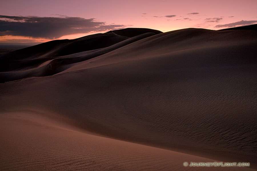 As I photographed this scene, I almost imagined myself in a foreign land as the sun dipped below the horizon.  The shapes of the dunes in this photo become abstract lines and patterns in the late dusk light. - Great Sand Dunes NP Photography