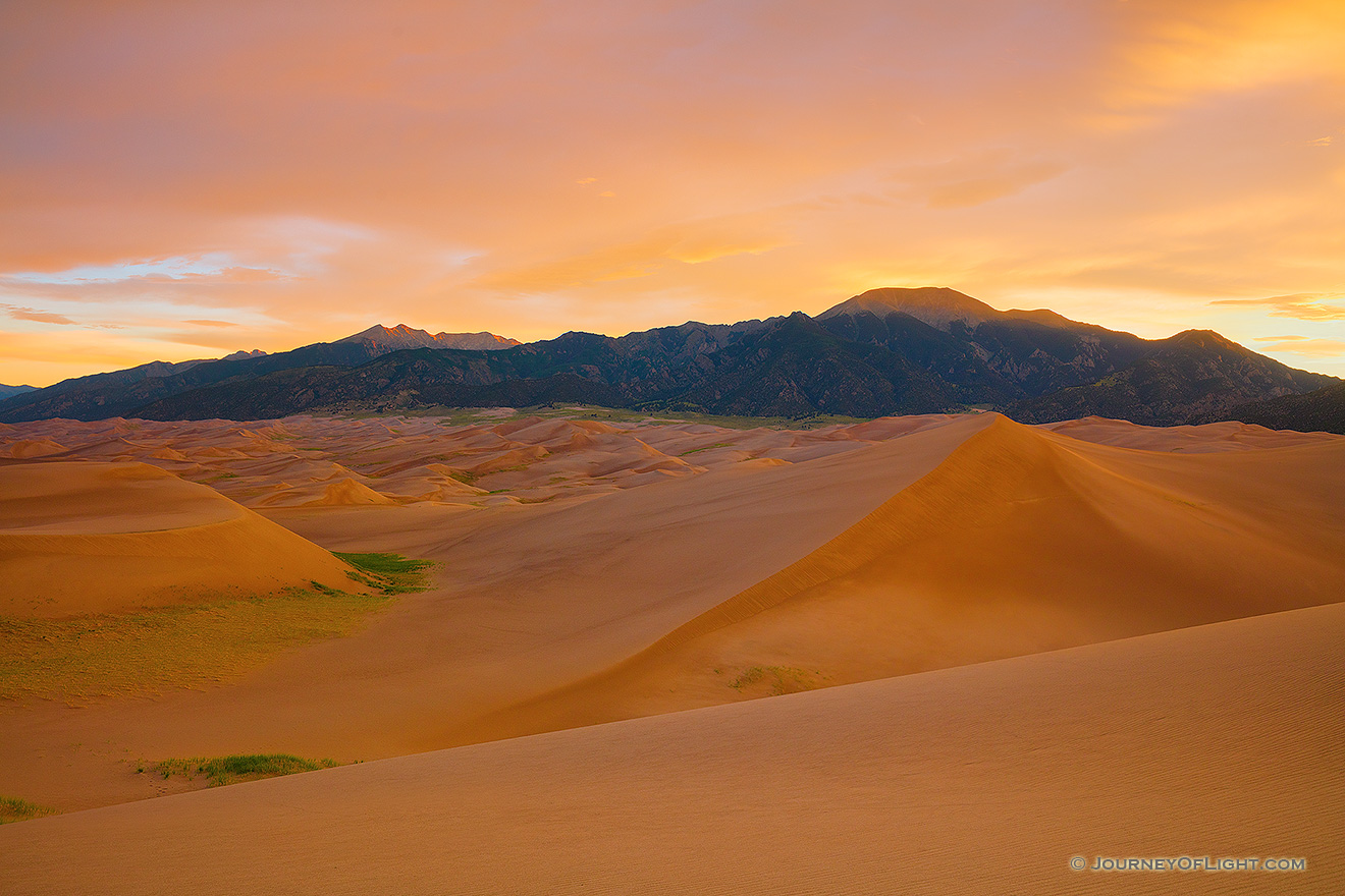 With no wind there is a complete silence on the dunes while the sunrise bathes the landscape in a warm glow a Great Sand Dunes National Park, Colorado. - Great Sand Dunes NP Picture