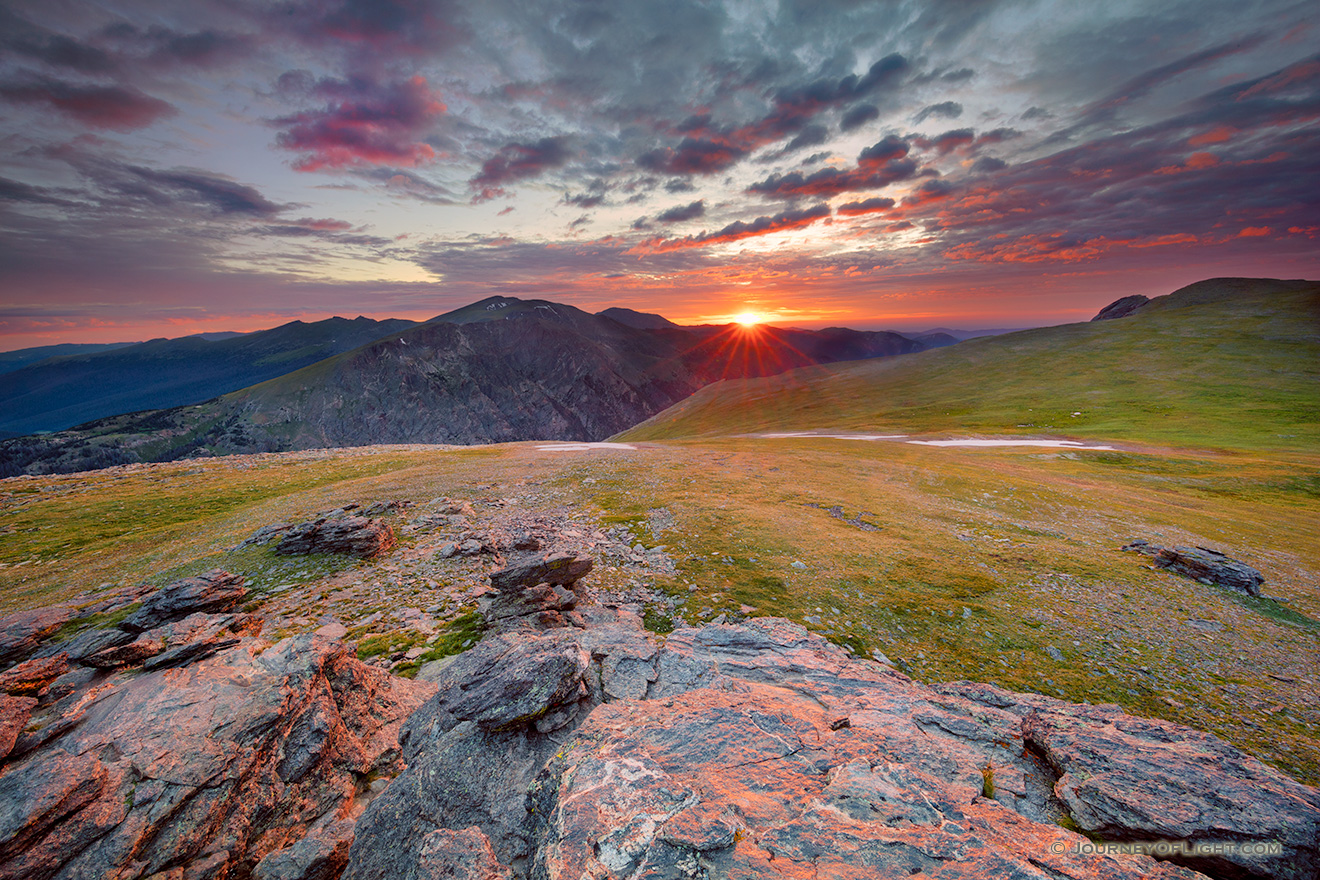A photograph of a beautiful sunset on the tundra landscape of Rocky Mountain National Park in Colorado. - Colorado Picture