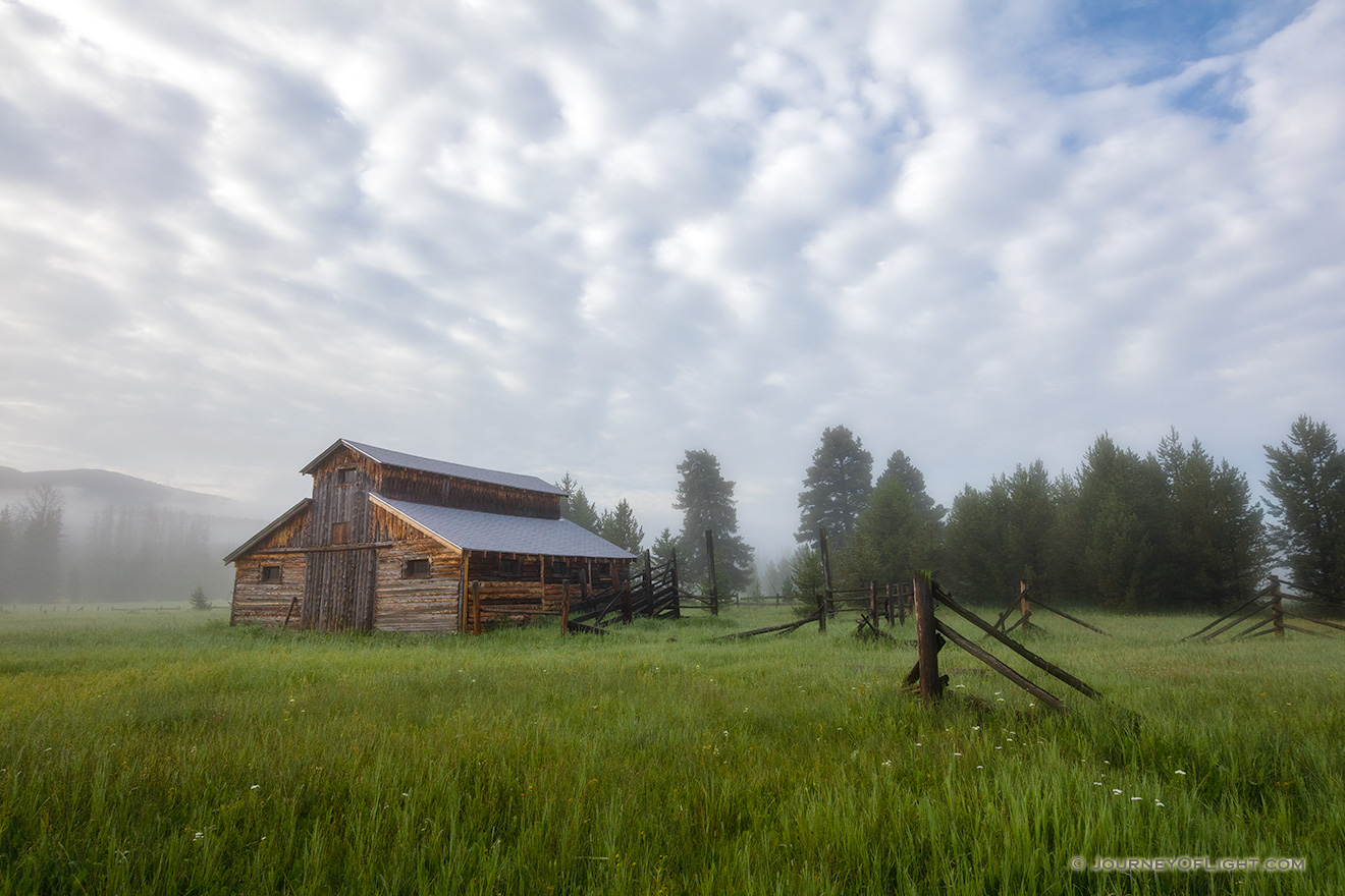 Fog rolls through the Kawuneeche Valley and surrounds this old rustic barn in Rocky Mountain National Park. - Colorado Picture