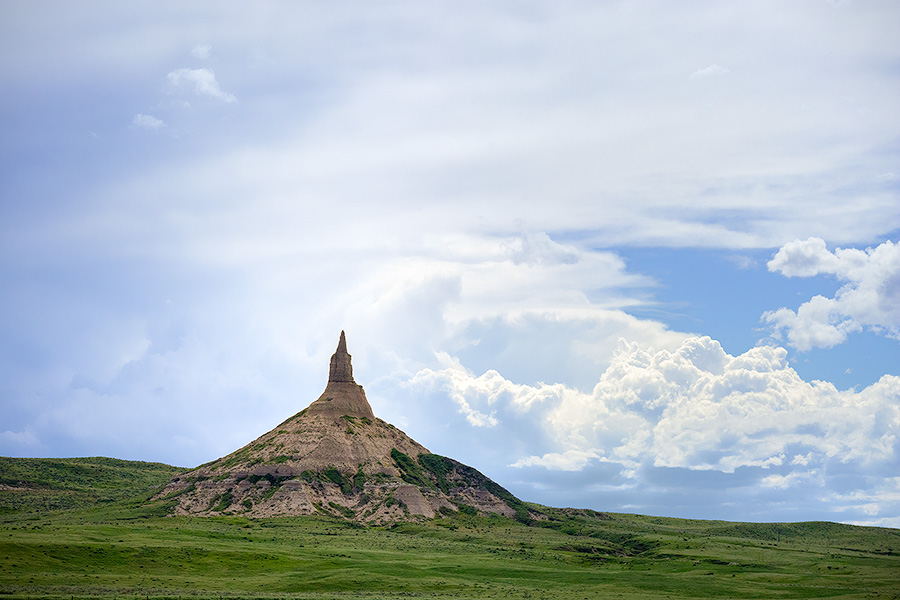 Afternoon storm clouds gather in the west billowing above Chimney Rock in the panhandle of Nebraska. - Nebraska Photography