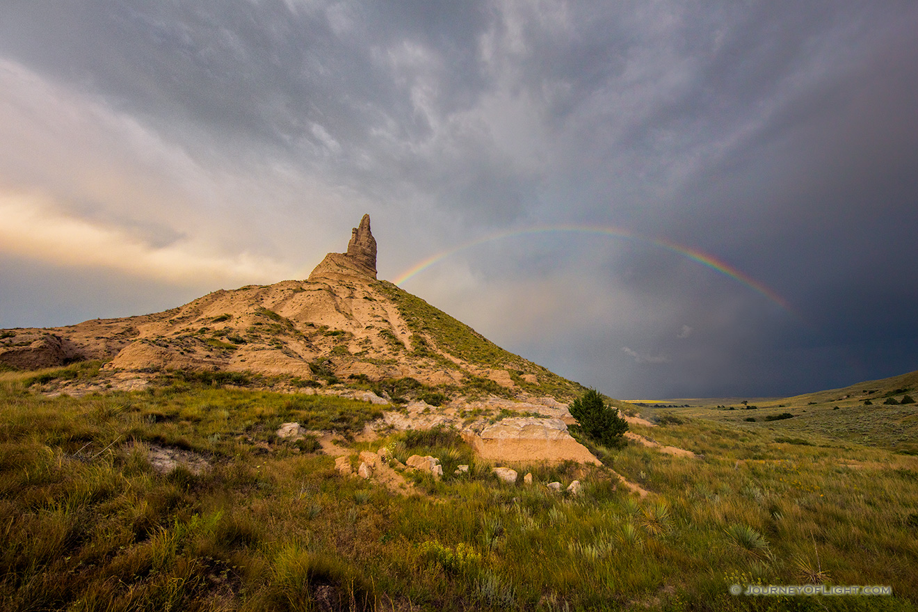 A scenic landscape Nebraska photograph of a rainbow over Chimney Rock in western Nebraska. - Nebraska Picture