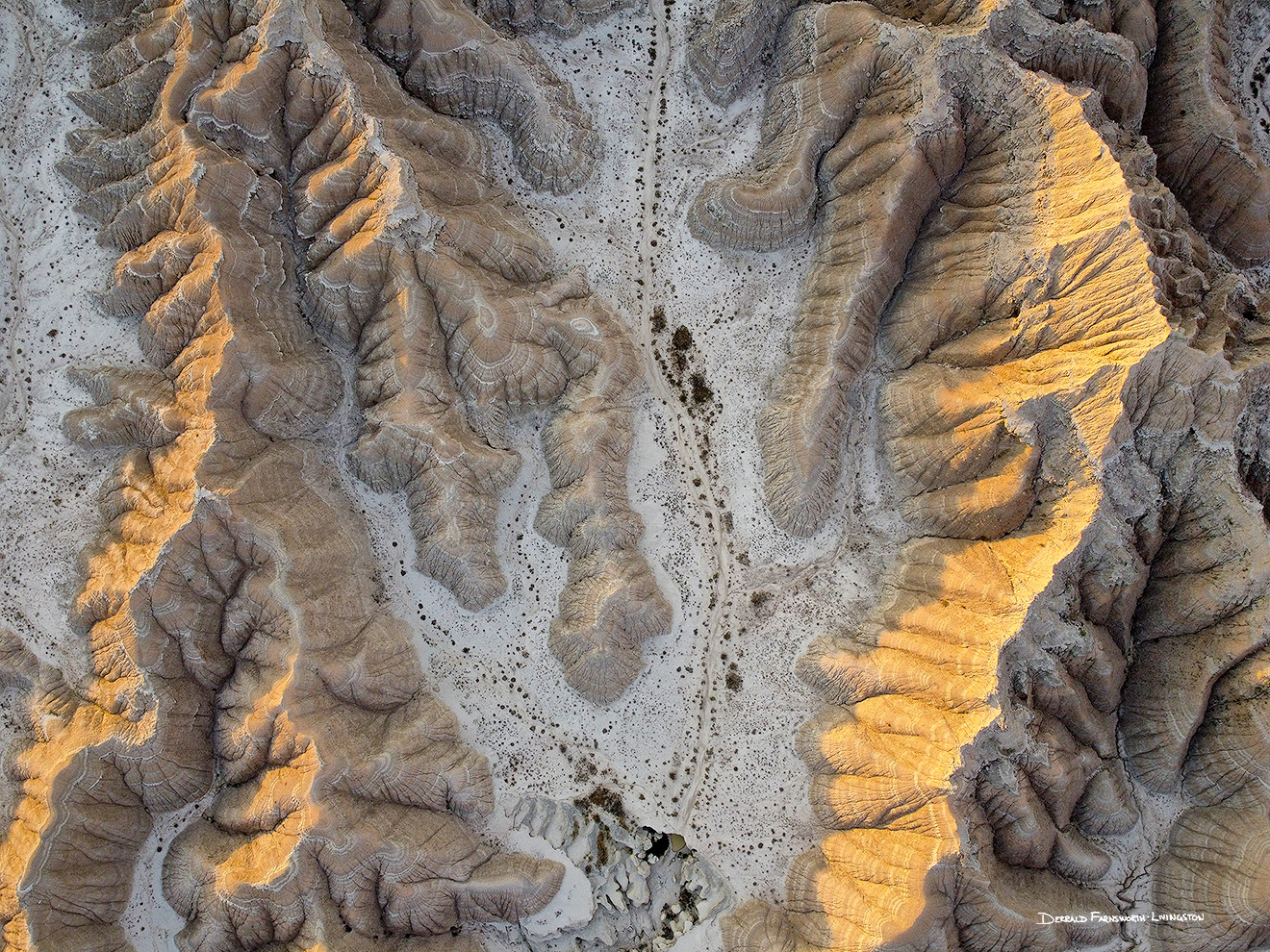 An abstract drone landscape photograph of the badlands Toadstool Geologic Park in western Nebraska. - Nebraska Picture