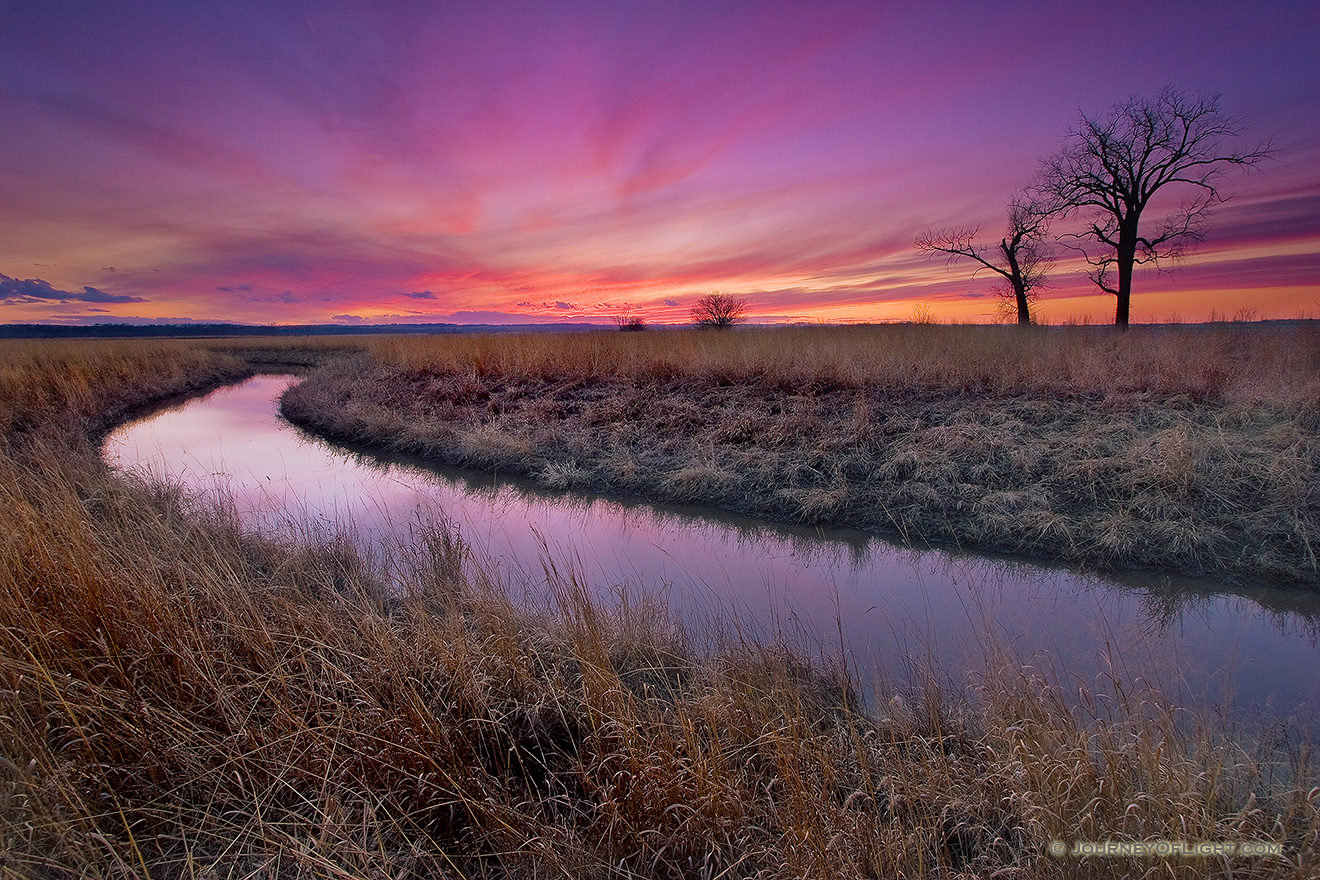 A small chute flows toward an early spring sunset through a tract of native prairie grasses at Boyer Chute National Wildlife Refuge near Ft. Calhoun. - Boyer Chute Picture