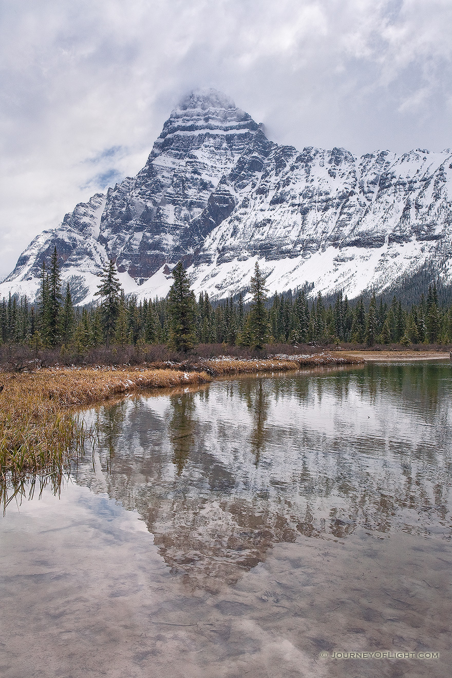 Mt. Cephron rises above the Mistaya River in Banff National Park, Alberta, Canada. - Banff Picture